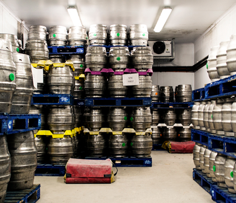 beer kegs in storage that are being temperature monitored