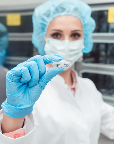 fertility clinic employee that is checking a temperature monitoring system